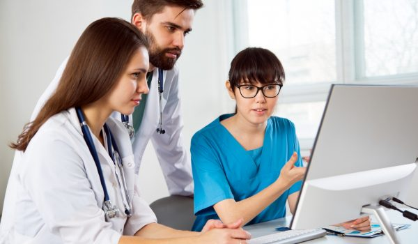 Group of doctors in the hospital discuss the diagnos of the patient
